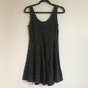 Dresses - Black sleeveless printed skater dress